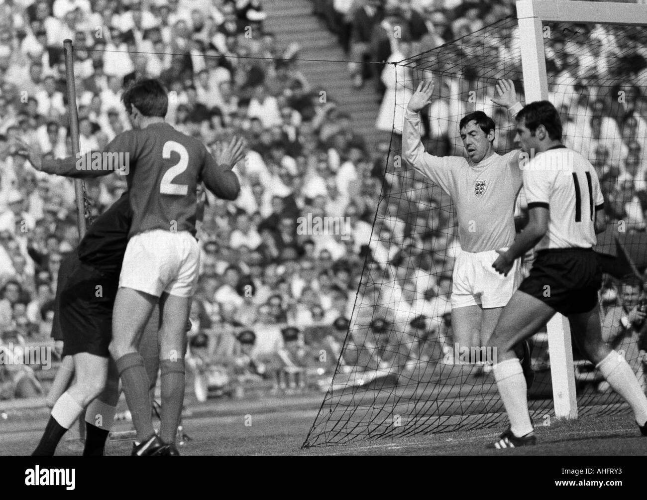 football, international match, 1968, Niedersachsen Stadium in Hanover, Germany versus England 1:0, scene of the match, f.l.t.r. Keith Newton (England, 2), keeper Gordon Banks (England), Georg Volkert (FRG) - Stock Image
