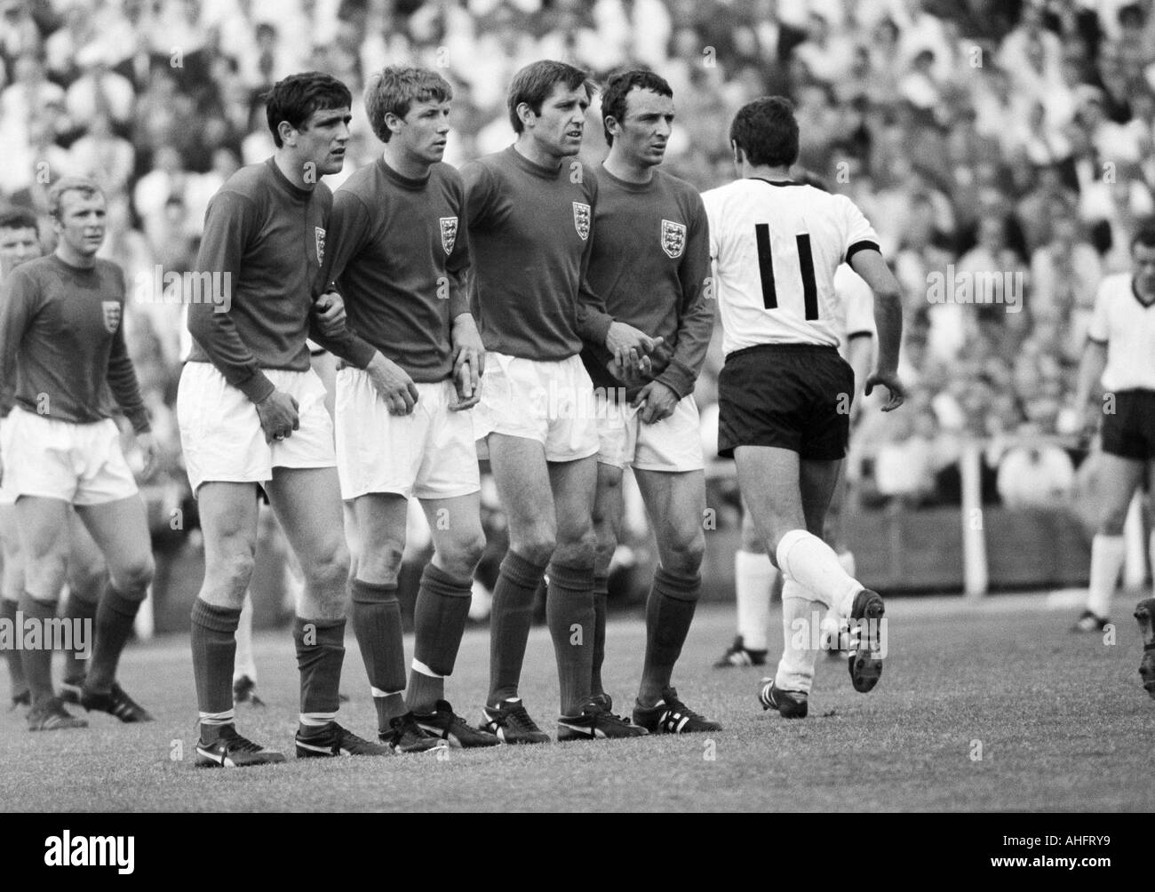 football, international match, 1968, Niedersachsen Stadium in Hanover, Germany versus England 1:0, scene of the match, free kick to Germany, f.l.t.r. Bobby Moore (England), Norman Hunter (England), Colin Bell (England), Keith Newton (England), Mike Summer - Stock Image