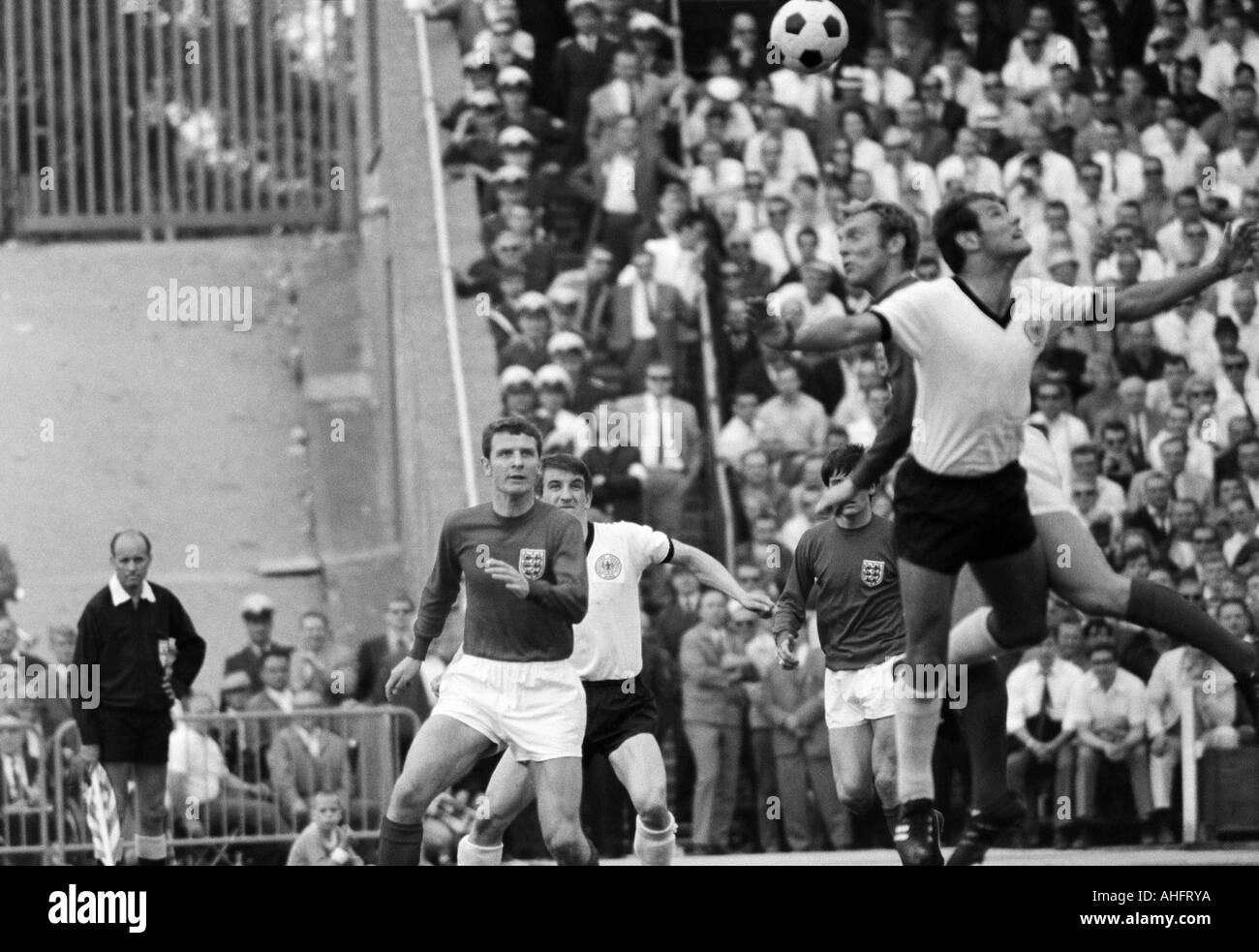 football, international match, 1968, Niedersachsen Stadium in Hanover, Germany versus England 1:0, scene of the match, f.l.t.r. Brian Labone (England), Hennes Loehr (FRG), Bobby Moore (England) in a header duel with Georg Volkert (FRG) - Stock Image