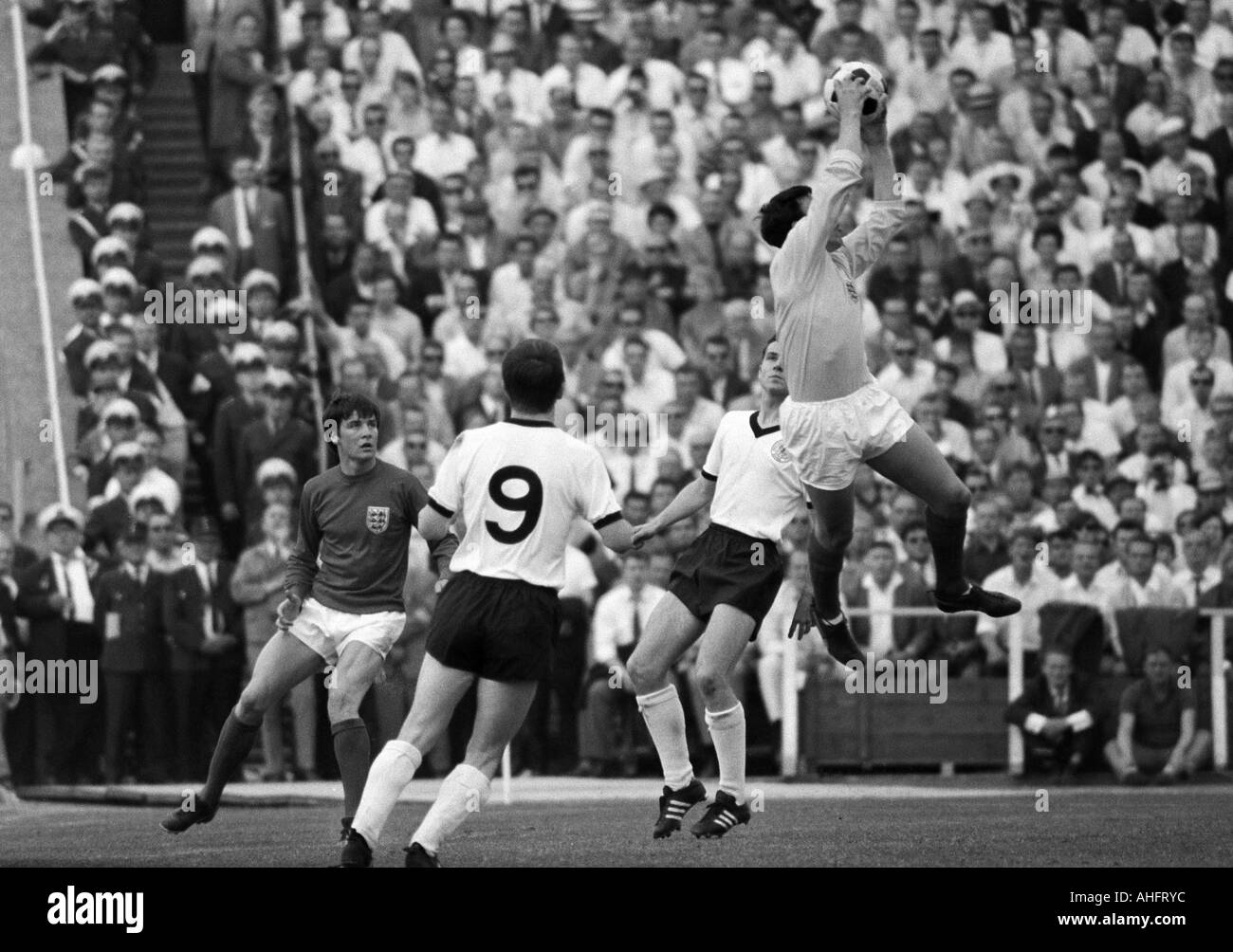football, international match, 1968, Niedersachsen Stadium in Hanover, Germany versus England 1:0, scene of the match, f.l.t.r. Cyril Knowles (England), Hennes Loehr (FRG, 9), Franz Beckenbauer (FRG), keeper Gordon Banks (England) - Stock Image