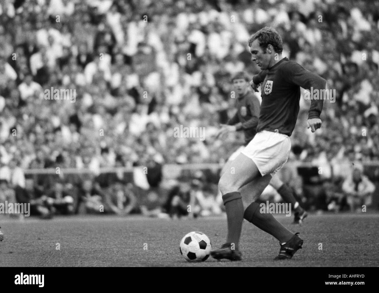 football, international match, 1968, Niedersachsen Stadium in Hanover, Germany versus England 1:0, scene of the match, Bobby Moore (England) in ball possession - Stock Image
