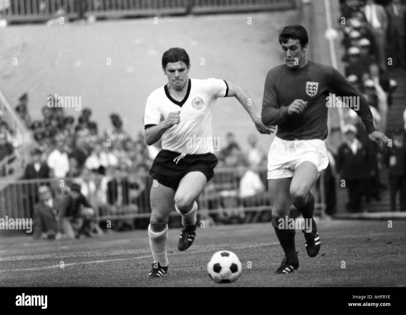 football, international match, 1968, Niedersachsen Stadium in Hanover, Germany versus England 1:0, scene of the match, duel between Wolfgang Weber (FRG) left and Geoff Hurst (England) - Stock Image