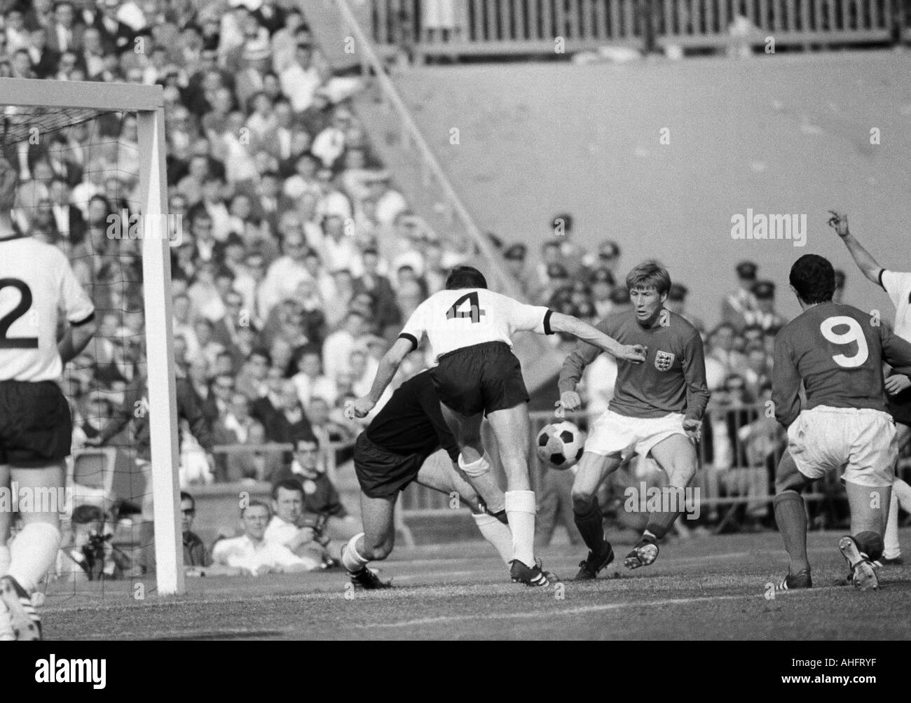 football, international match, 1968, Niedersachsen Stadium in Hanover, Germany versus England 1:0, scene of the match, f.l.t.r. Berti Vogts (FRG, 2), keeper Horst Wolter (FRG), Ludwig Mueller (FRG, 4), Colin Bell (England), Mike Summerbee (England, 9) - Stock Image