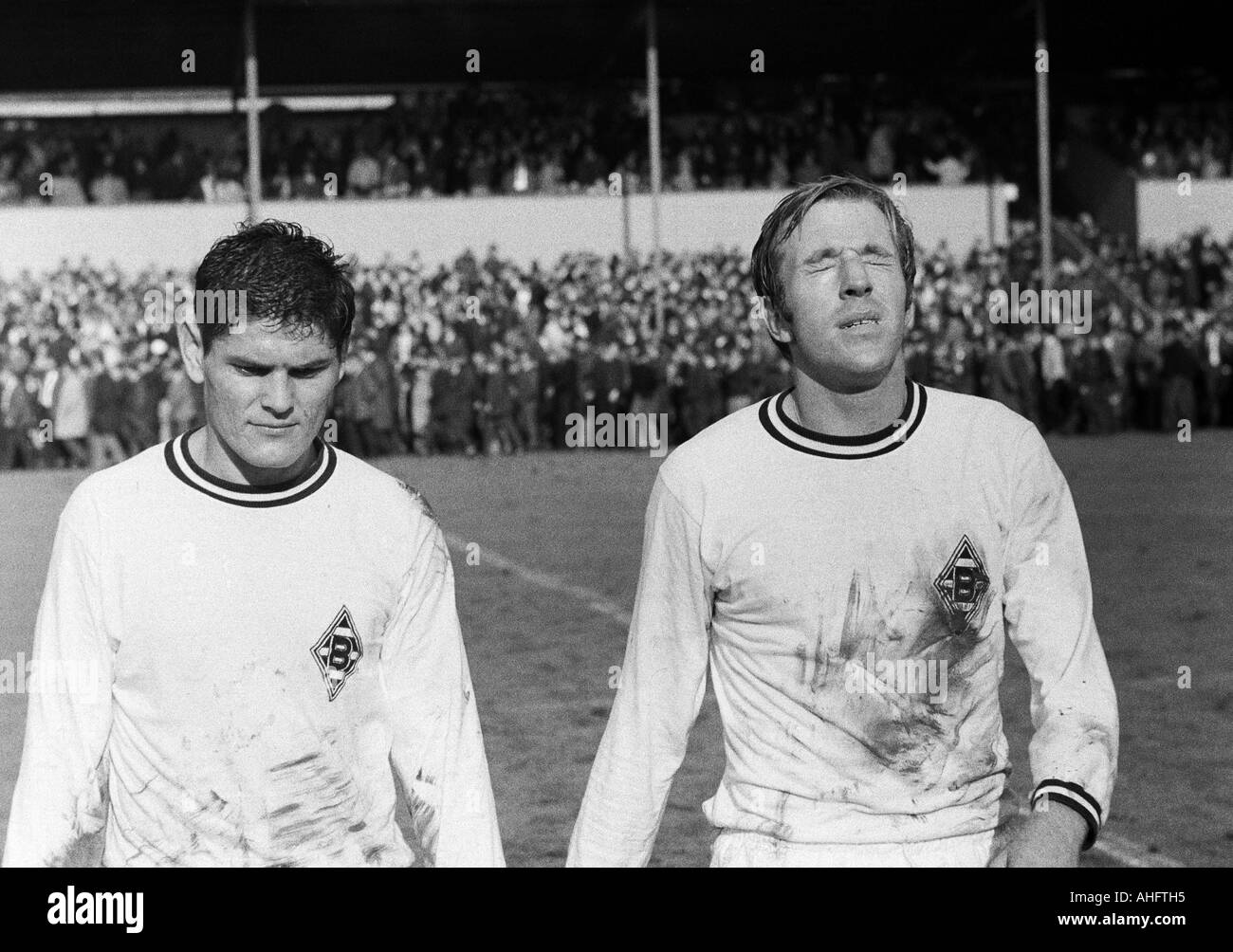 football, Bundesliga, 1968/1969, Borussia Dortmund versus Borussia Moenchengladbach 1:3, Rote Erde Stadium, football players leaving the pitch, left Heinz Wittmann, right Guenter Netzer (both Gladbach) - Stock Image