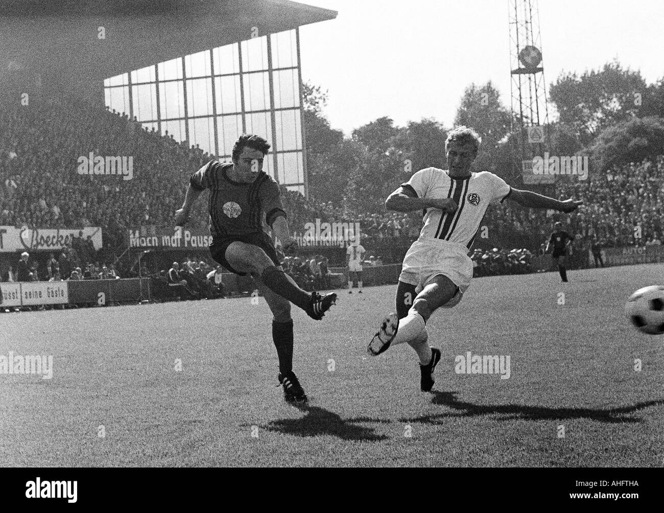 football, Regionalliga West, 1968/1969, Stadium an der Hafenstrasse in Essen, Rot-Weiss Essen versus Bayer Leverkusen 2:2, scene of the match, shot on goal by Friedhelm Strelczyk (Bayer) left, right Heinz Stauvermann (RWE) - Stock Image