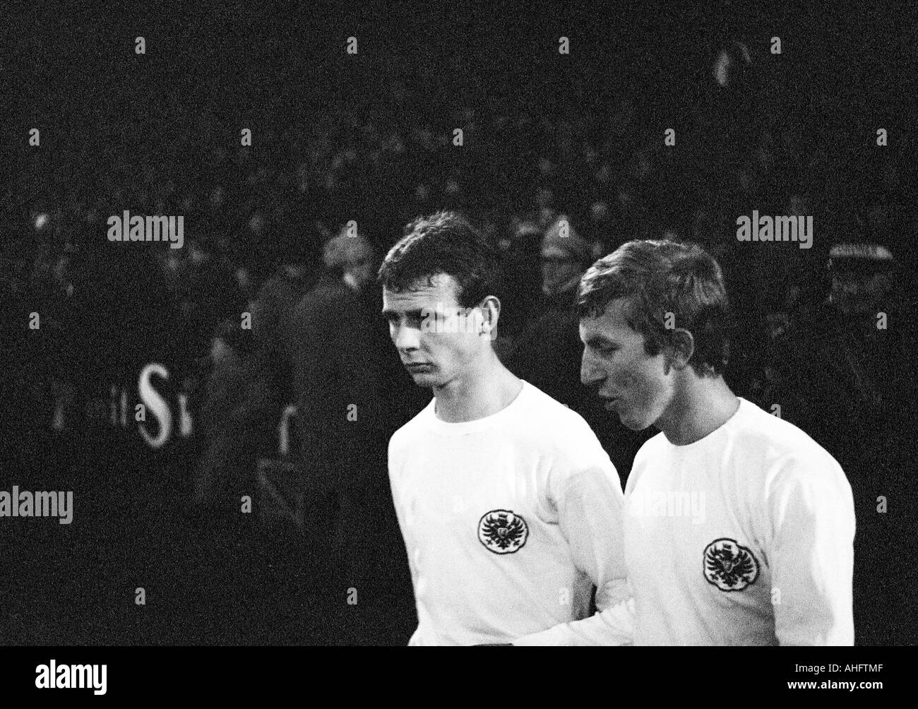 football, Bundesliga, 1968/1969, FC Schalke 04 versus Eintracht Frankfurt 2:0, Glueckaufkampfbahn Stadium in Gelsenkirchen, football players, left Bernd Hoelzenbein, right Juergen Grabowski (both Frankfurt) - Stock Image