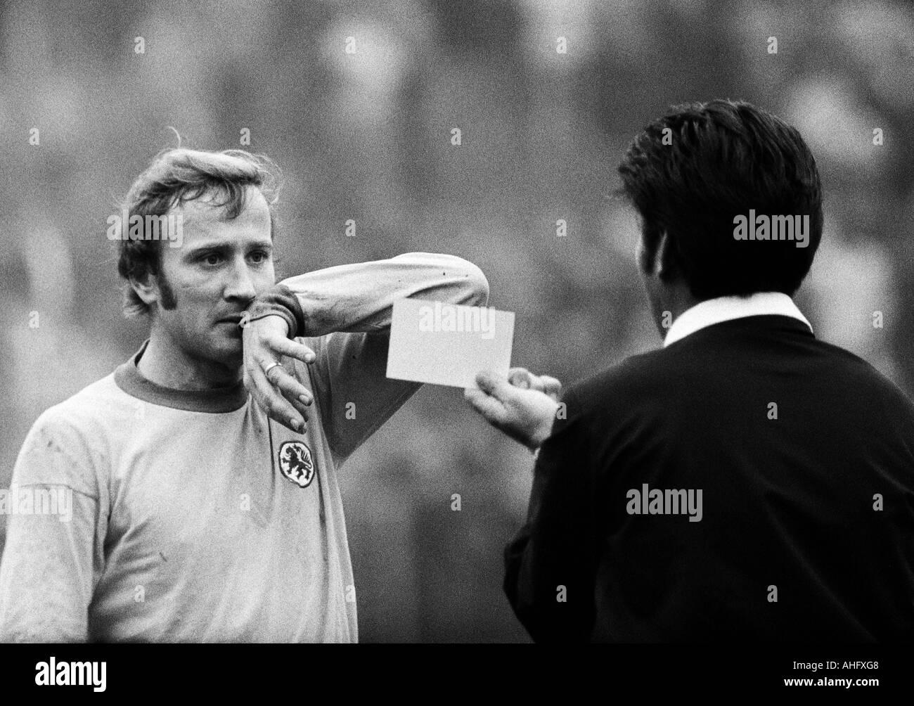 football, Bundesliga, 1972/1973, Boekelberg Stadium, Borussia Moenchengladbach versus Eintracht Brunswick 4:0, scene of the match, referee Dieter Berner from Enzberg yellow-cards Wolfgang Grzyb (BS) - Stock Image