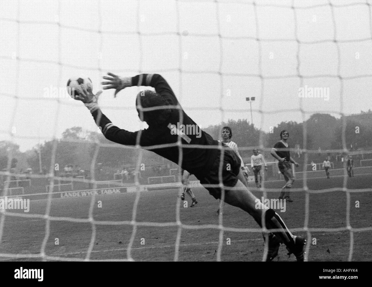 football, Regionalliga West, 1973/1974, Niederrhein Stadium in Oberhausen, Rot-Weiss Oberhausen versus Sportfreunde Siegen 3:1, scene of the match, save by keeper Detlef Behrens (Siegen) at a long-range shot - Stock Image