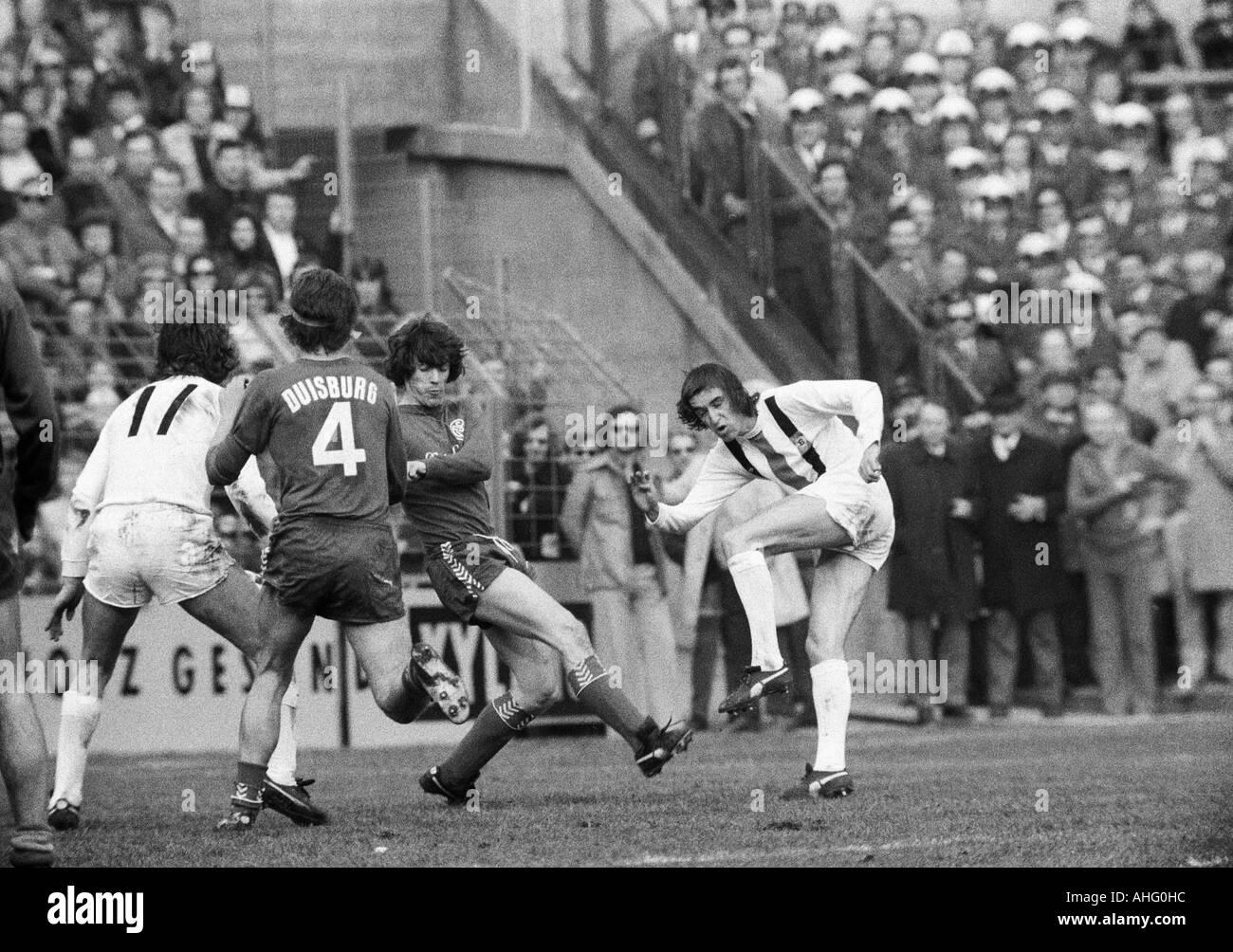 football, Bundesliga, 1973/1974, Boekelberg Stadium, Borussia Moenchengladbach versus MSV Duisburg 3:2, scene of the match, f.l.t.r. Jupp Heynckes (MG), a Duisburg player (4), Theo Buecker (MSV), Dietmar Danner (MG) - Stock Image