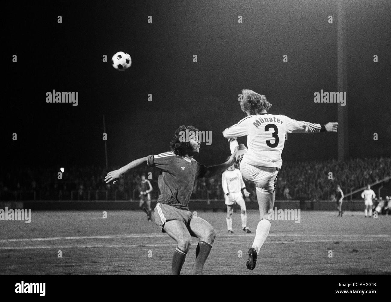football, second Bundesliga North, 1974/1975, Rot-Weiss Oberhausen versus Preussen Muenster 2:1, Niederrhein Stadium in Oberhausen, scene of the match, duel between Walter Krause (RWO) left and a Muenster player (3) - Stock Image