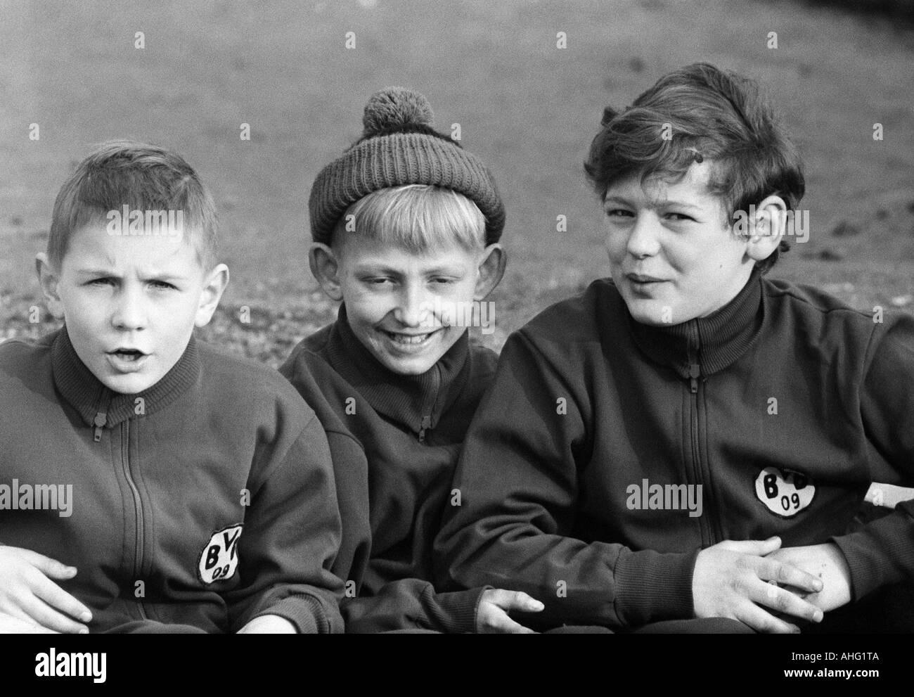 football, Bundesliga, 1966/1967, Borussia Dortmund versus Borussia Moenchengladbach 3:2, Stadium Rote Erde in Dortmund, three young boys, fans of Borussia Dortmund - Stock Image
