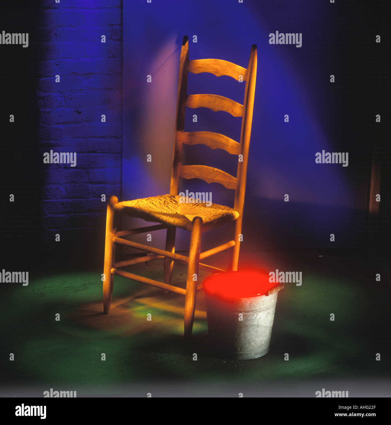 Glowing Chair and Bucket - Stock Image