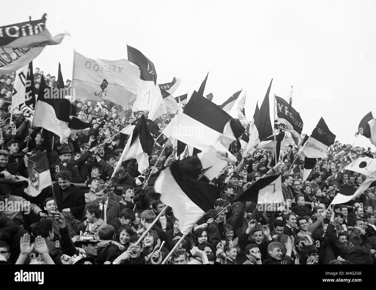 football, Bundesliga, 1966/1967, Borussia Moenchengladbach versus Hanover 96 2:0, Boekelberg Stadium, crowd of spectators, Moenchengladbach fans waving their club flags - Stock Image