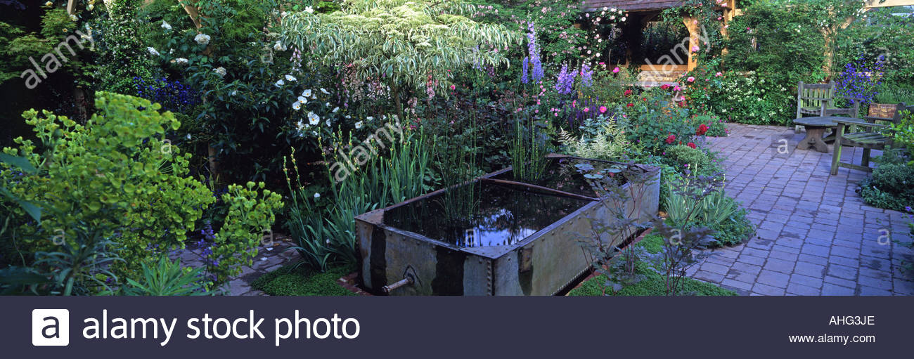 Country garden with water feature and summer planting. Roger Platts ...