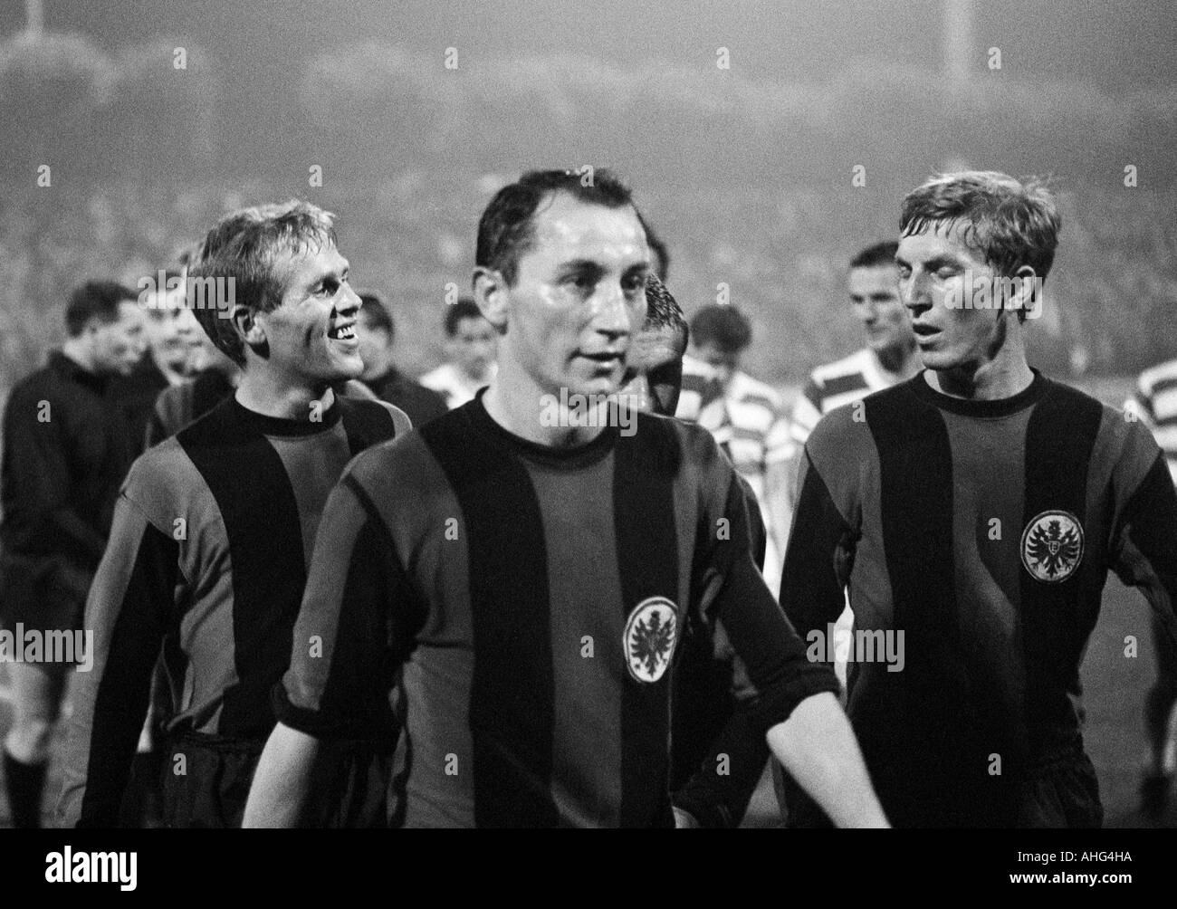 football, Bundesliga, 1967/1968, Wedau Stadium in Duisburg, MSV Duisburg versus Eintracht Frankfurt 0:1, football players leaving the pitch, f.l.t.r. Siegfried Bronnert, Fahrudin Jusufi, Juergen Grabowski (all Frankfurt) - Stock Image
