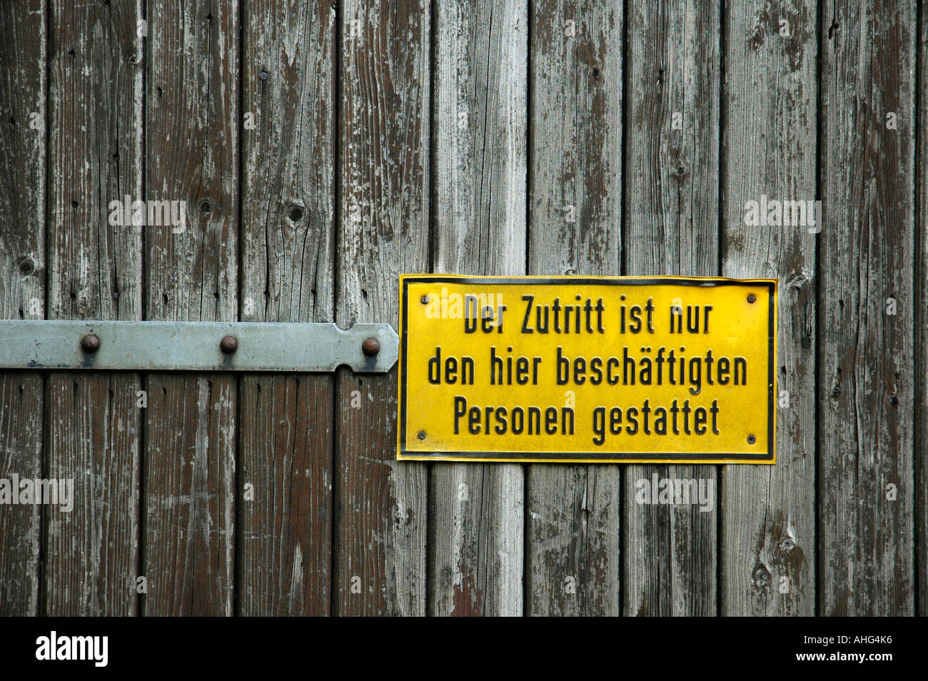 Yellow sign on wooden door, no entry Stock Photo