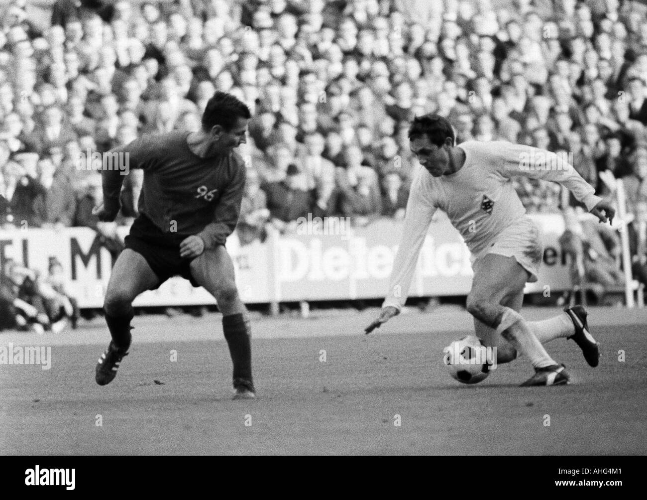football, Bundesliga, 1967/1968, Borussia Moenchengladbach versus Hanover 96 5:1, Boekelberg Stadium, scene of the match, duel between Christian Breuer (Hannover, left) and Peter Meyer (MG) - Stock Image