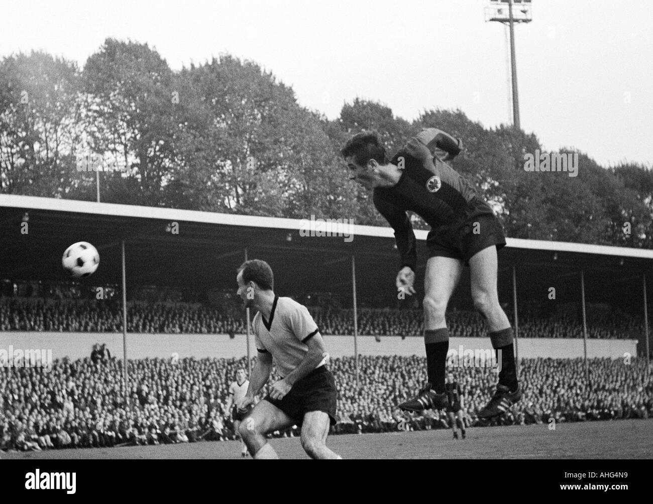 football, Bundesliga, 1967/1968, Borussia Dortmund versus Eintracht Frankfurt 2:1, Stadium Rote Erde in Dortmund, scene of the match, header by Ernst Abbe (Frankfurt, right), left Wilhelm Sturm (BVB) - Stock Image
