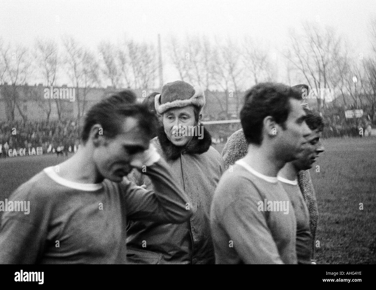 football, Bundesliga, 1968/1969, Glueckaufkampfbahn Stadium in Gelsenkirchen, FC Schalke 04 versus Kickers Offenbach 3:0, football players leaving the pitch, f.l.t.r. Reinhard Libuda, coach Rudolf Gutendorf, Franz Hasil, Klaus Senger (all Schalke) - Stock Image