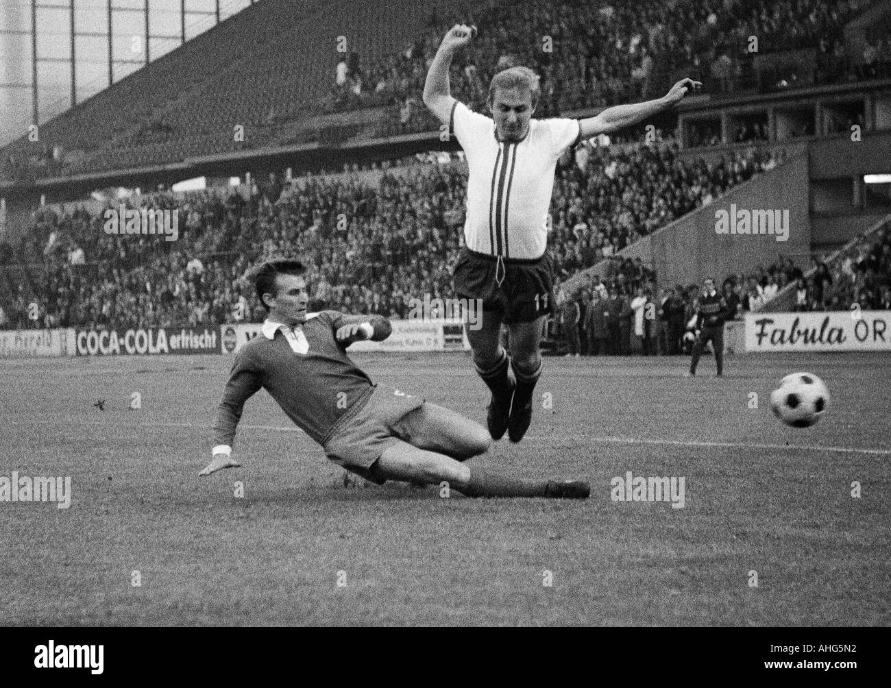 football, Bundesliga, 1968/1969, Wedau Stadium in Duisburg, MSV Duisburg versus 1. FC Kaiserslautern 0:0, scene of the match, duel between Manfred Mueller (Duisburg) left and Gerhard Kentschke (Kaiserslautern) - Stock Image