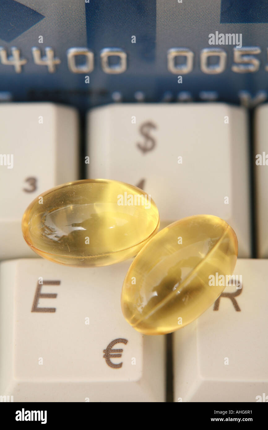 Pills On A Computer Keyboard Near To Euro And Dollar Sign As A