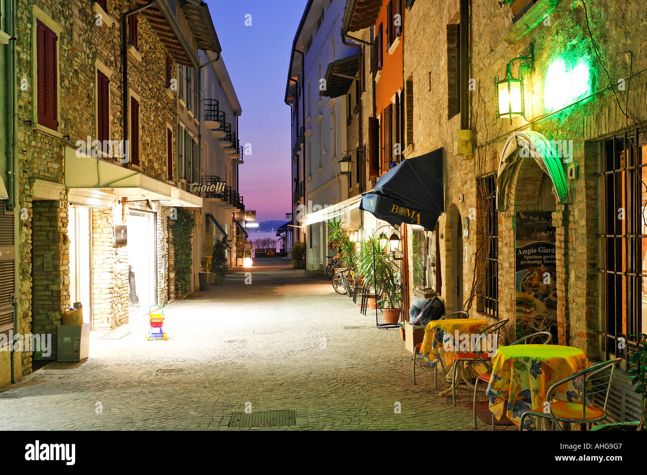 In springtime the restaurants are seldomly visited in the tourist town of Sirmione, Lake Garda, Italy - Stock Image