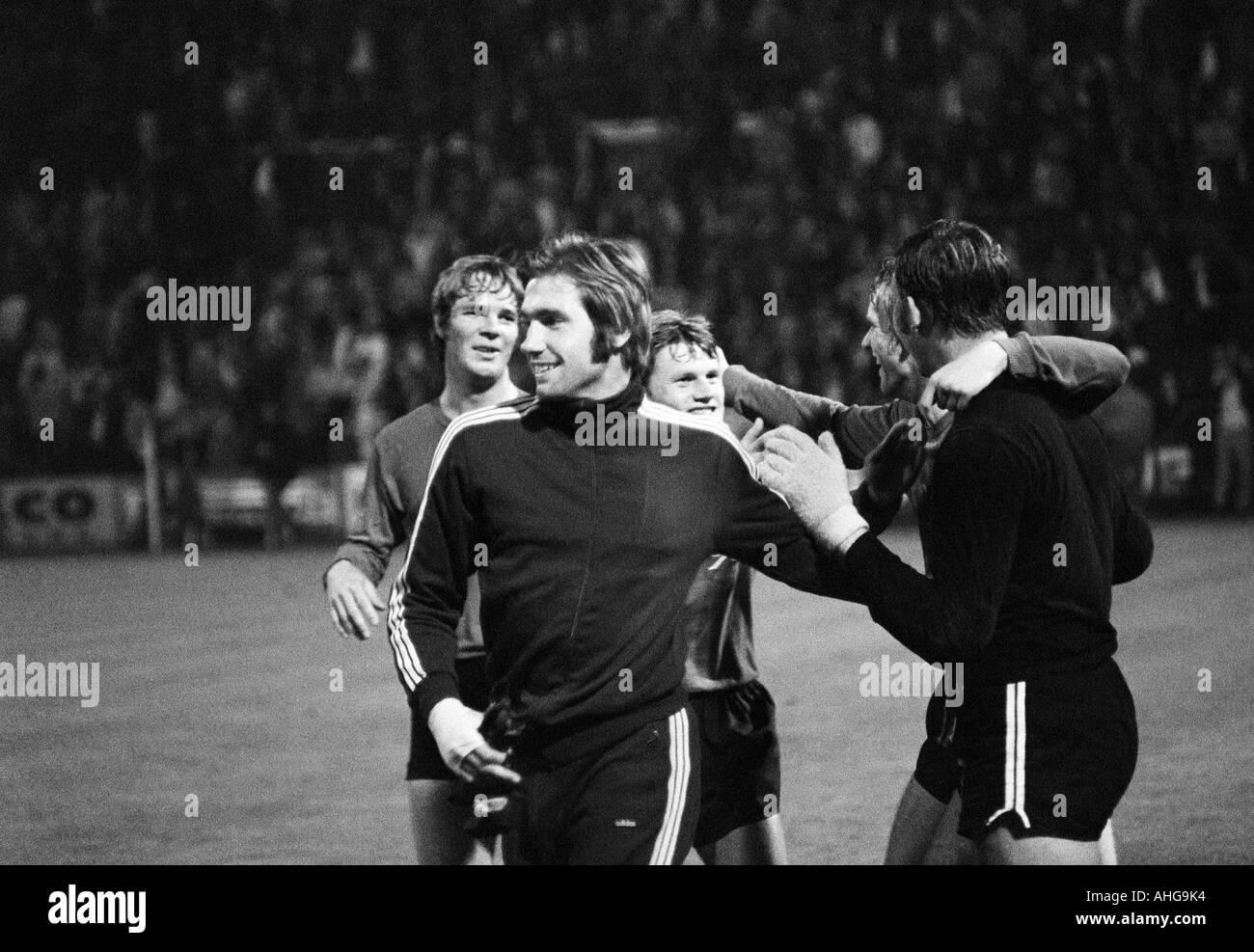 football, Bundesliga, 1970/1971, Borussia Moenchengladbach versus Hanover 96 0:0, Boekelberg Stadium, football players rejoicing at the draw, f.l.t.r. Peter Anders, Peter Loof, Rainer Stiller, keeper Horst Podlasly (all 96) - Stock Image