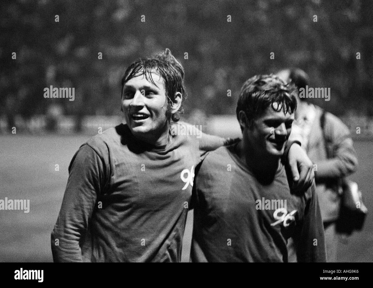 football, Bundesliga, 1970/1971, Borussia Moenchengladbach versus Hanover 96 0:0, Boekelberg Stadium, football players rejoicing at the draw, left Ferdinand Keller, right Rainer Stiller (both 96) - Stock Image