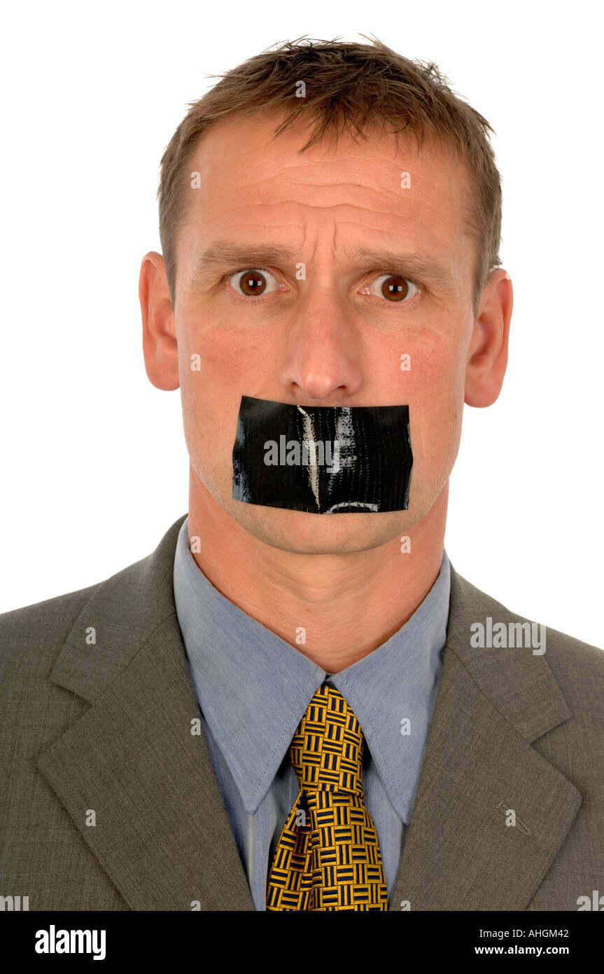 Man with gaffer tape across his mouth - Stock Image