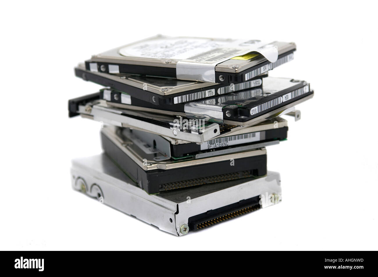 Pile of laptop hard discs against a white background - Stock Image