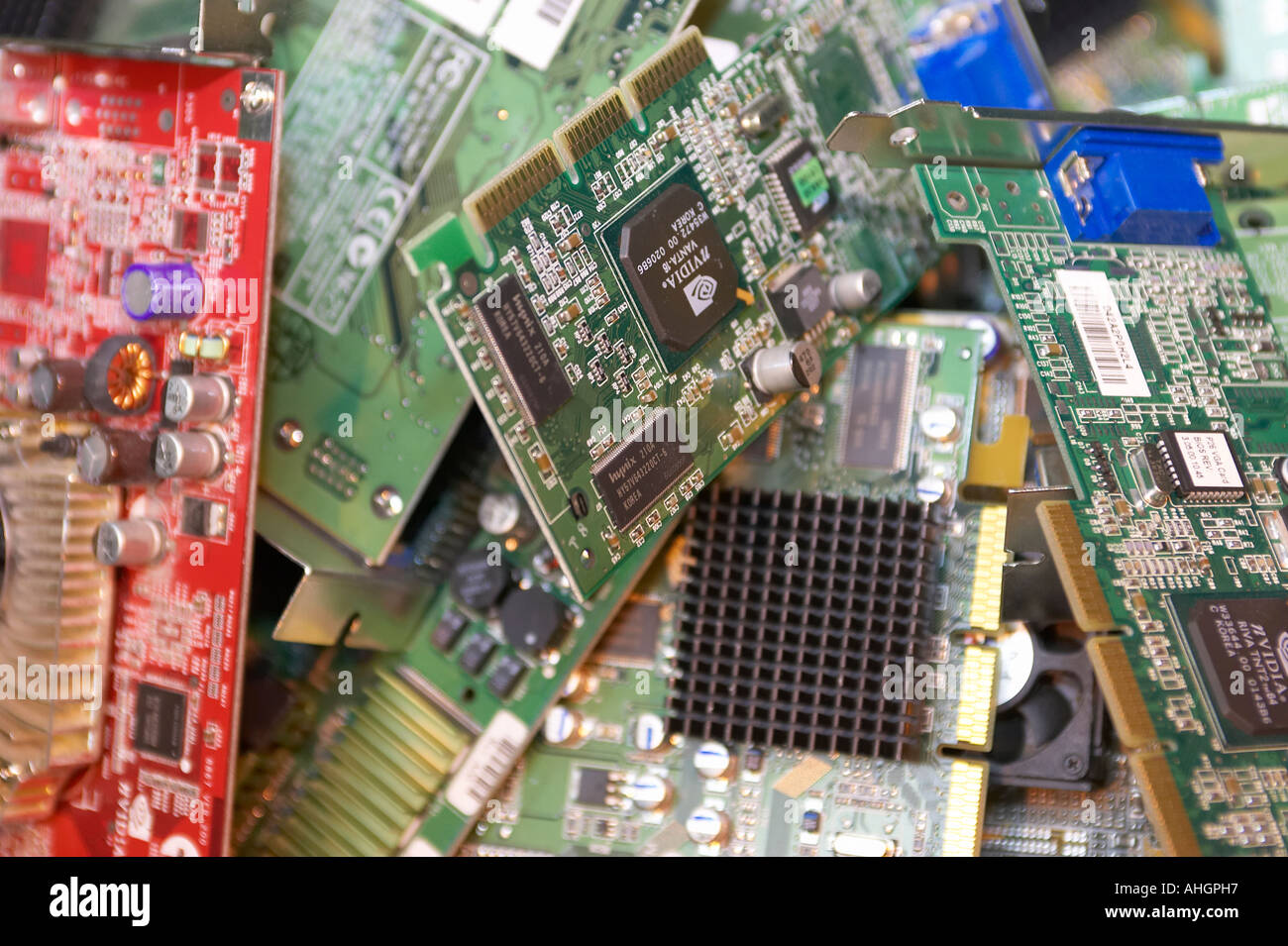 various computer component internal circuit boards including video card in a pile waiting to be recycled - Stock Image