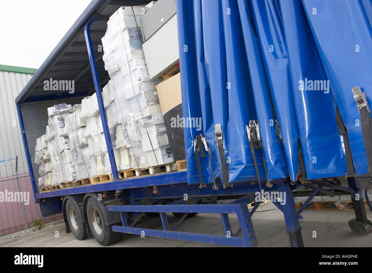 Open Side Of Blue Curtain Lorry Trailer Containing Pallets