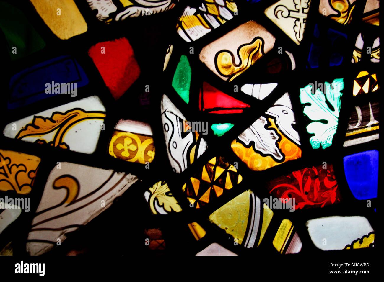 Shropshire Moreton Corbett St Bartholomews Church stained glass fragments England UK GB - Stock Image