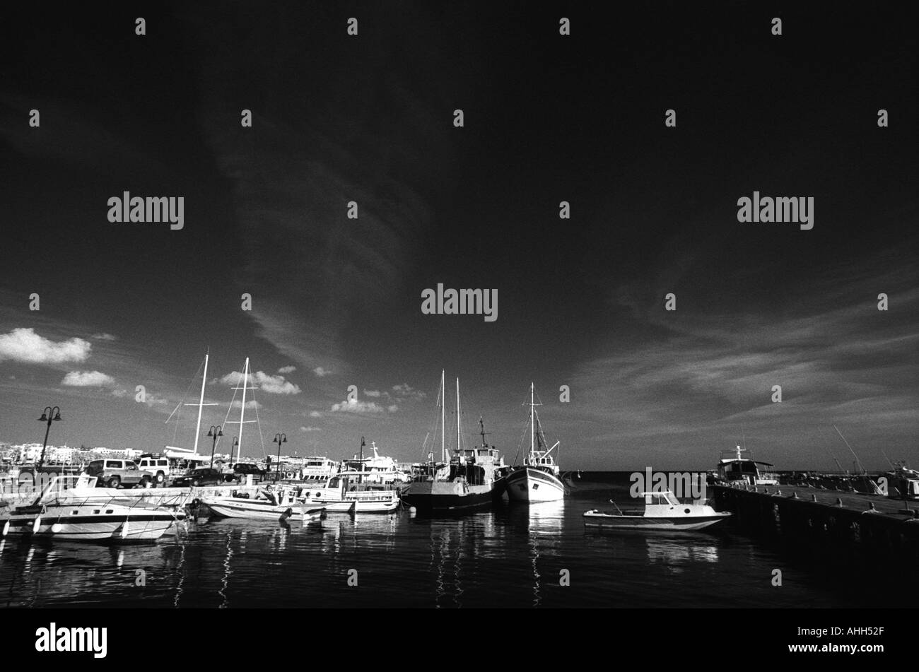 Paphos Harbor, with ships and boats in calm, safe anchorage - Stock Image
