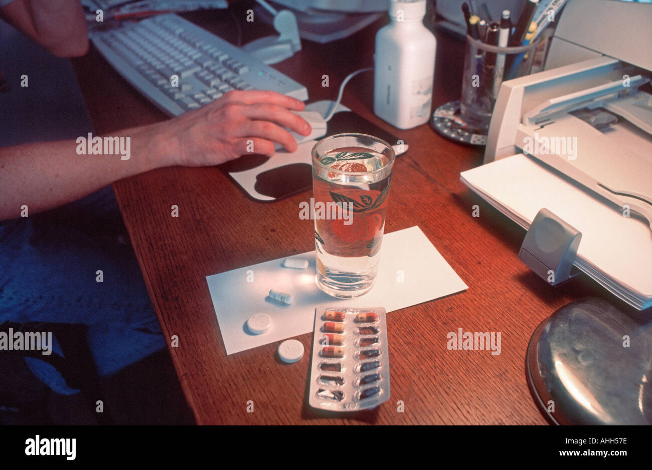 Medical HAART AIDS anti Viral Medication Male Patient at Home Office Working on Computer, Detail Close up, Medicines Tablets - Stock Image