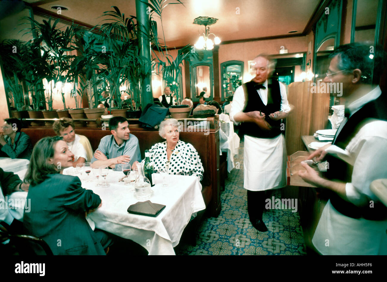French Restaurant, Paris Bistro 'Au Petit Marguery' , Family Sharing Meals, Talking to Waiters, at Table Inside - Stock Image