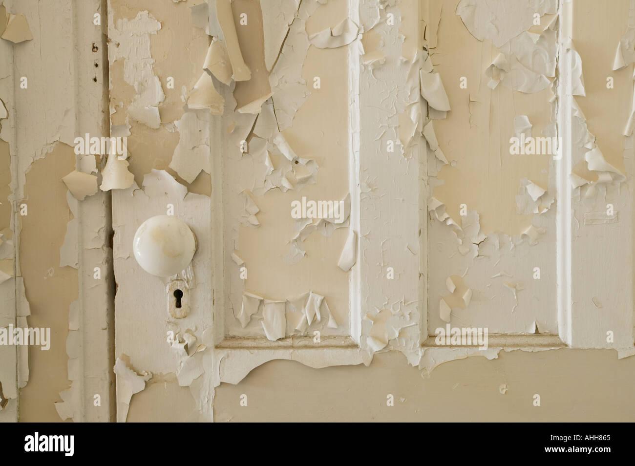 Peeling paint on a door - Stock Image
