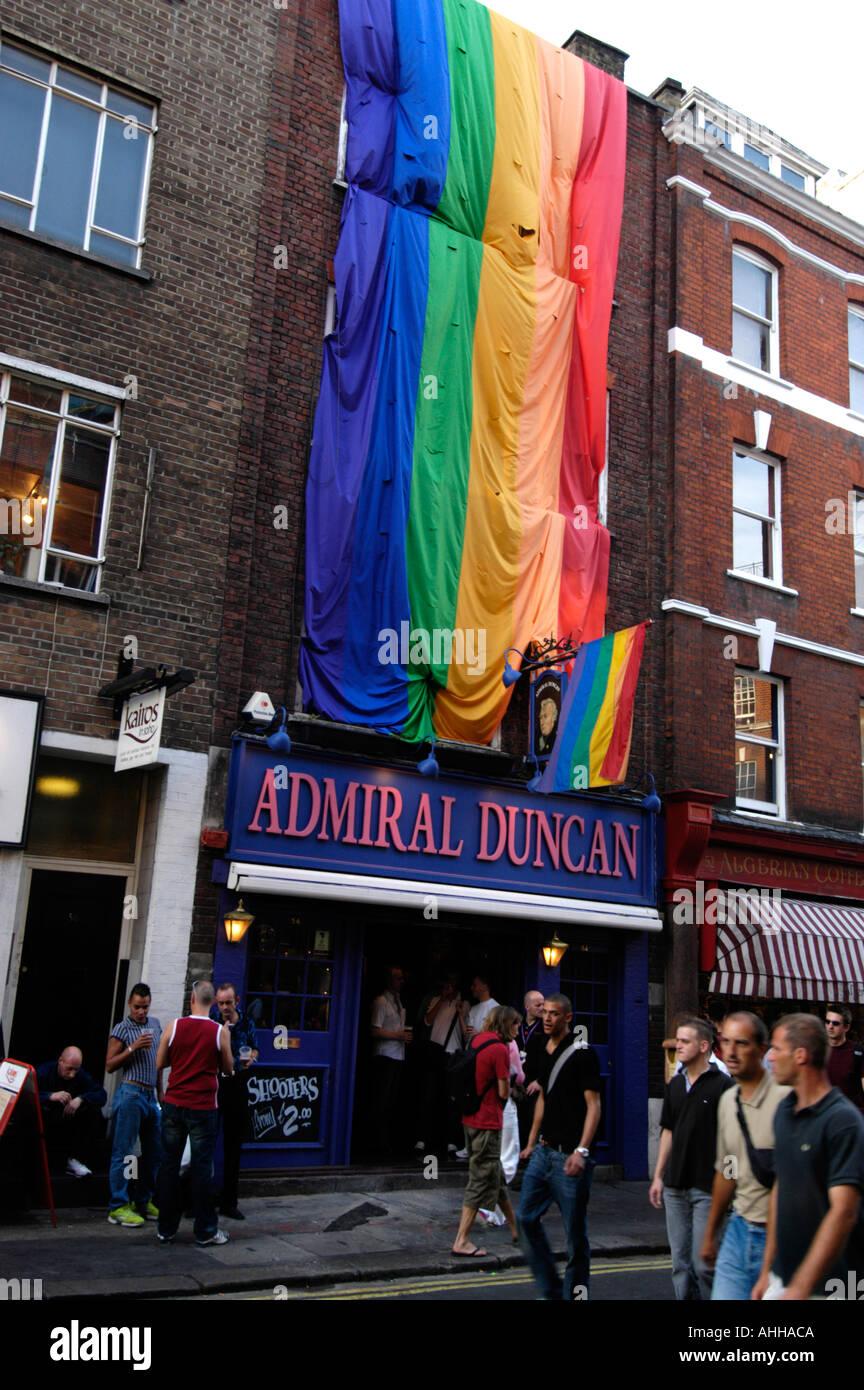 Gay rainbow flag outside Admiral Duncan pub in Old Compton Street, Soho, London England UK - Stock Image
