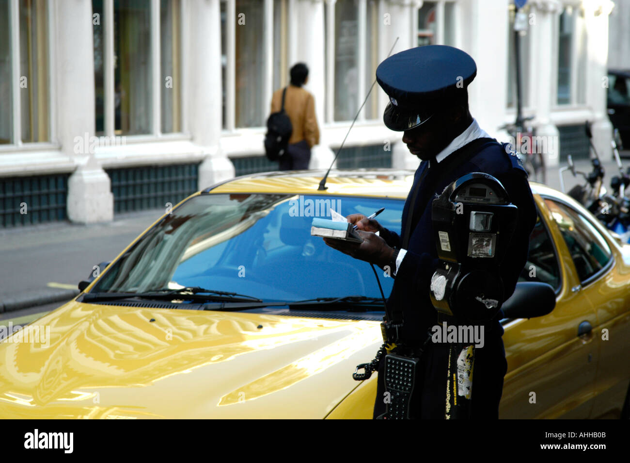 Parking attendant issuing a fine in Westminster London England UK - Stock Image