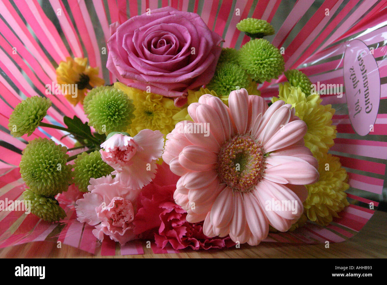 A Bunch Of Flowers And Pick Cellophane Wrapper Stock Photo