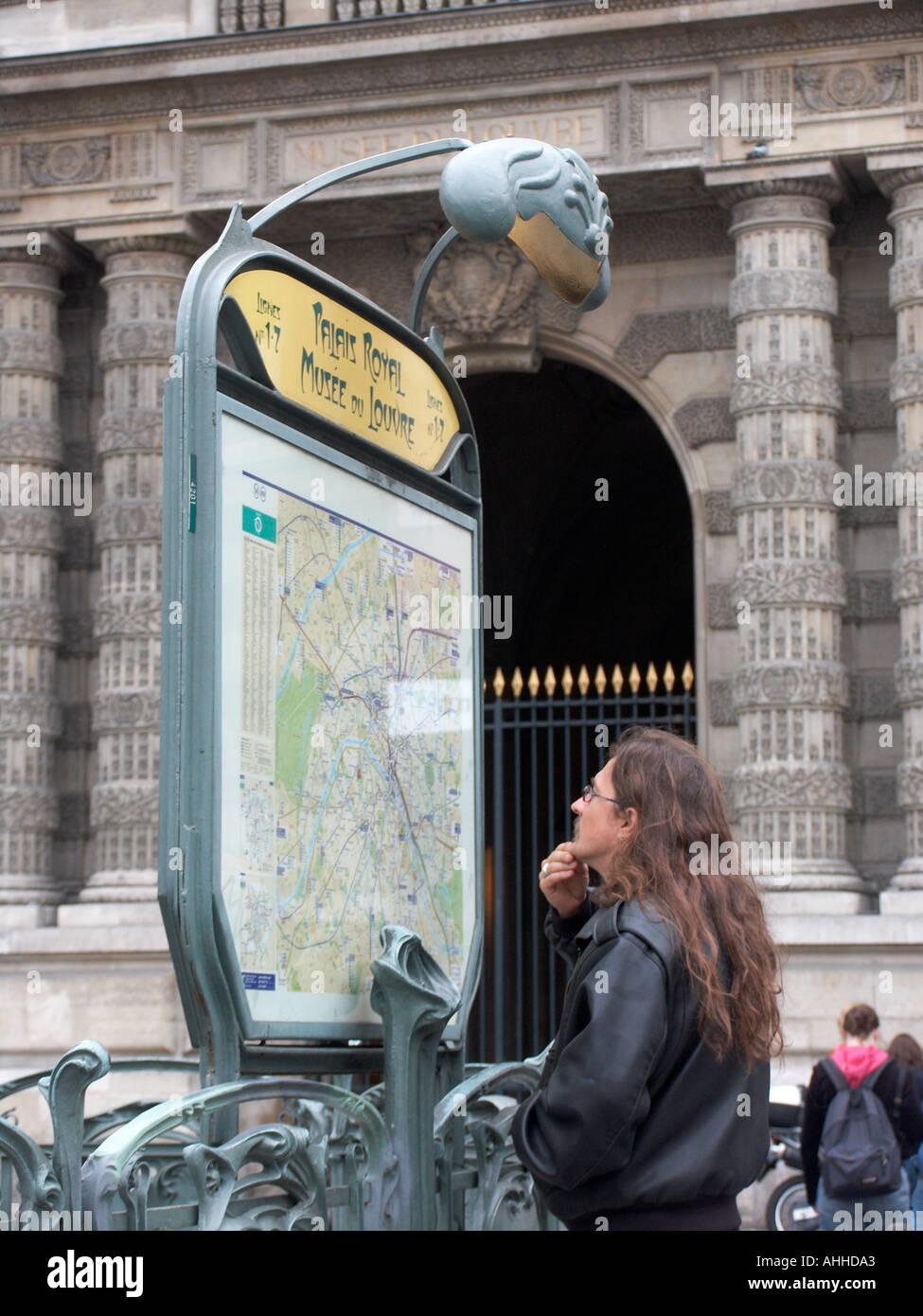 Man Looking At Subway Map.Man Looks At Metro Map At The Musee Du Louvre Subway Entrance Paris