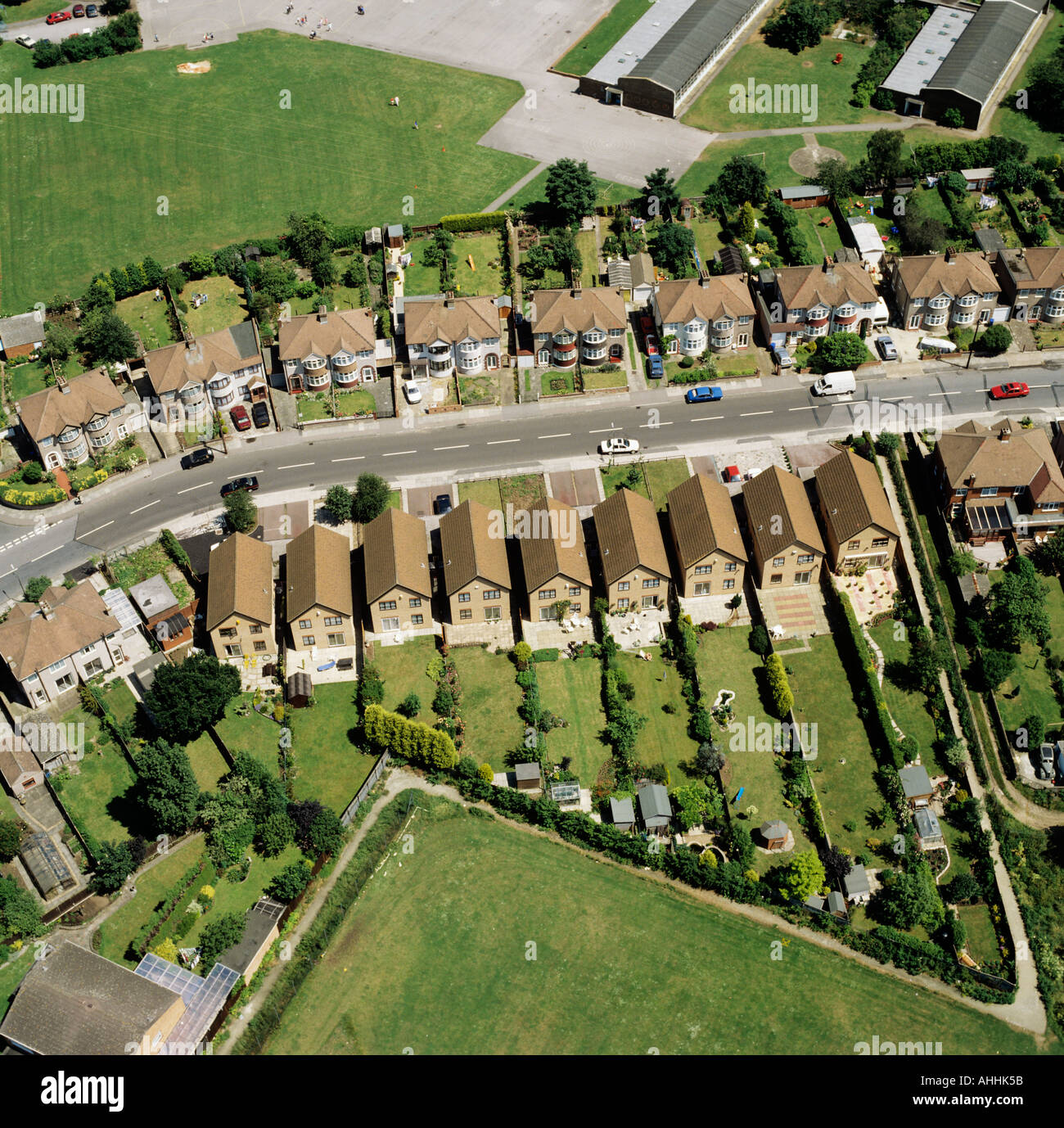 Suburban semi detached and detached housing UK aerial view - Stock Image