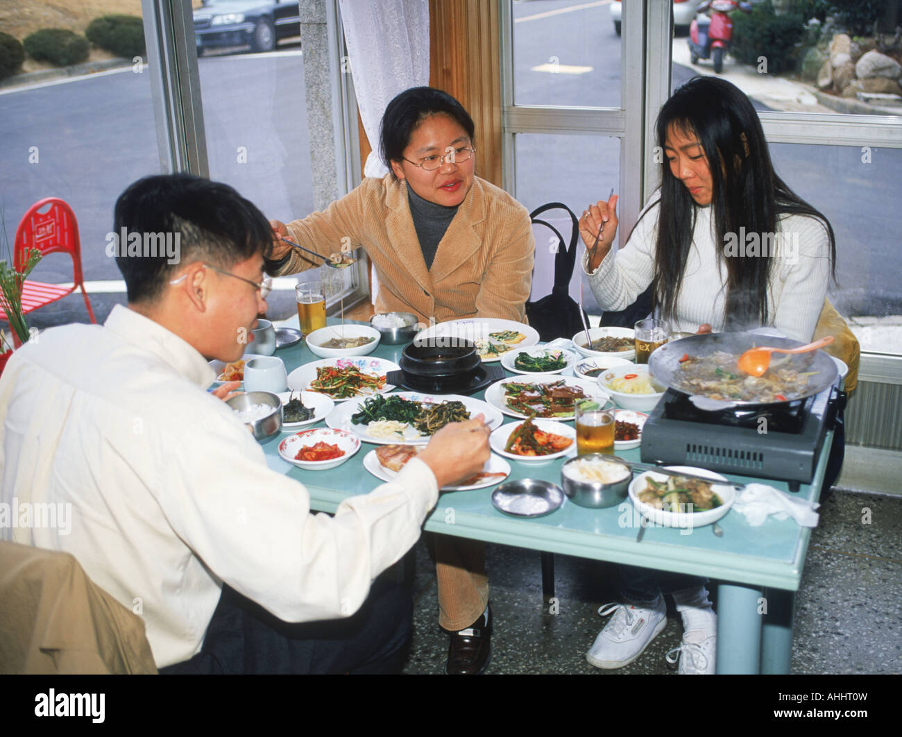 Friends eating meal in typical restaurant in South Korea Stock Photo