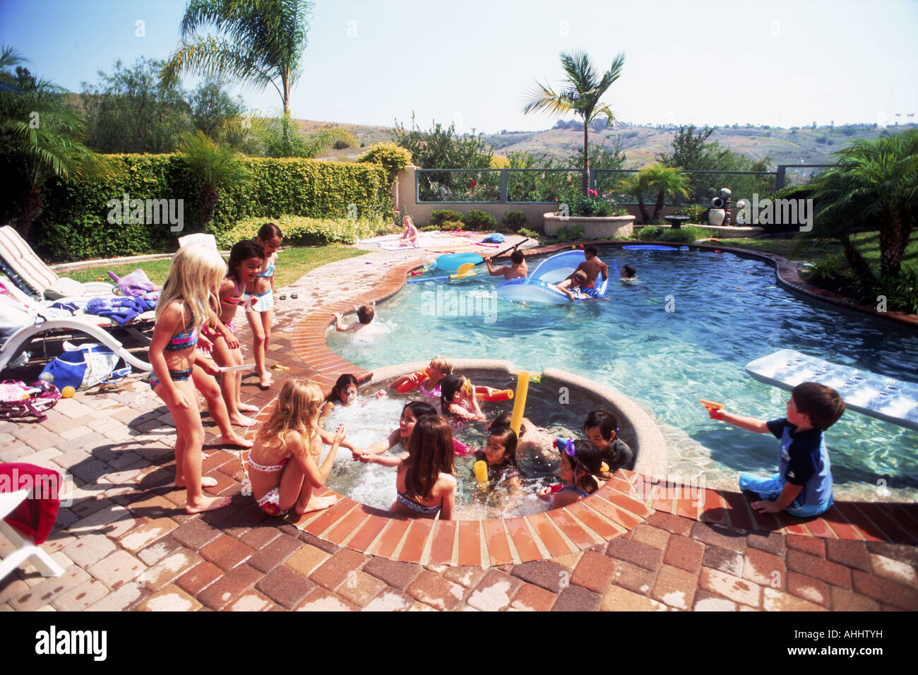 Kids Playing In Backyard Swimming Pool And Jacuzzi Stock Photo Alamy