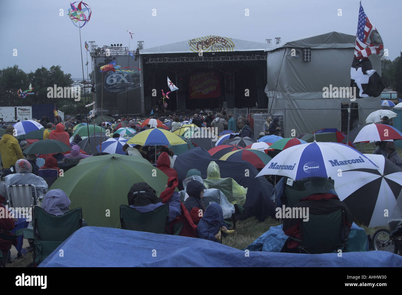 Audience at Cropredy Folk Festival during the rain - Stock Image