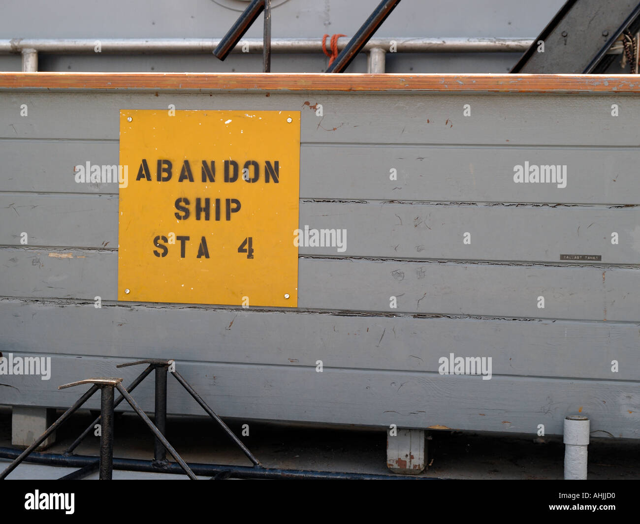 Rear deck of a US Navy cutter displays an abandon ship sign - Stock Image