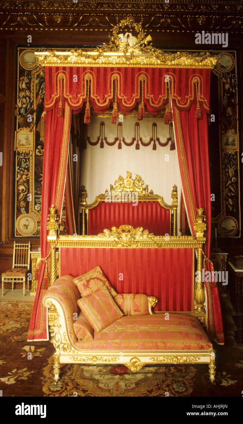 Burghley House, near Stamford, interior, bedroom, gilded 4 poster bed bedroom, drapes curtains English stately home - Stock Image