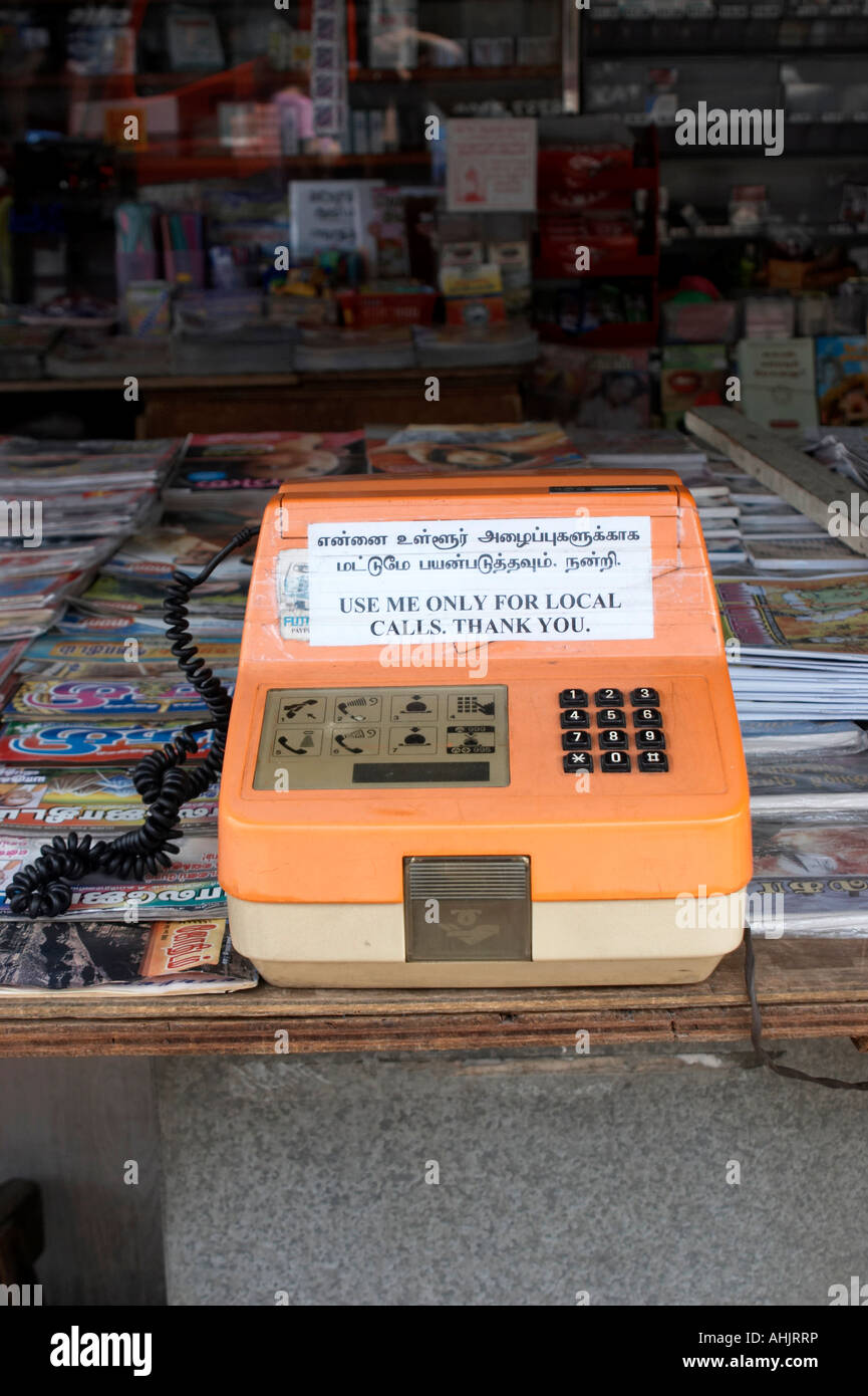 Pay phone for local calls only at Market Stall - Stock Image