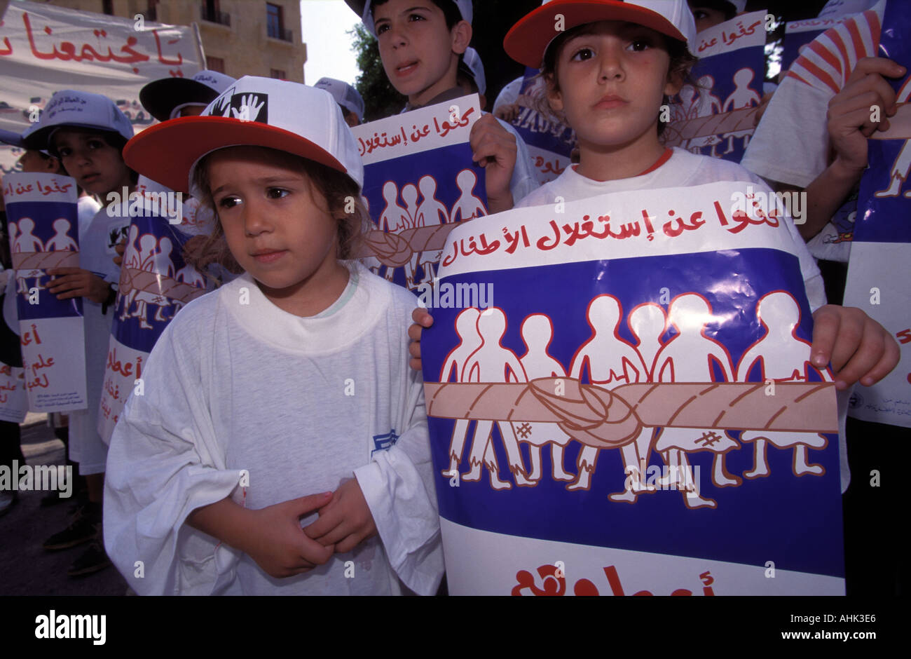 Young Lebanese children demonstrate in downtown Beirut against the worldwide exploitation of child labour Beirut Lebanon - Stock Image