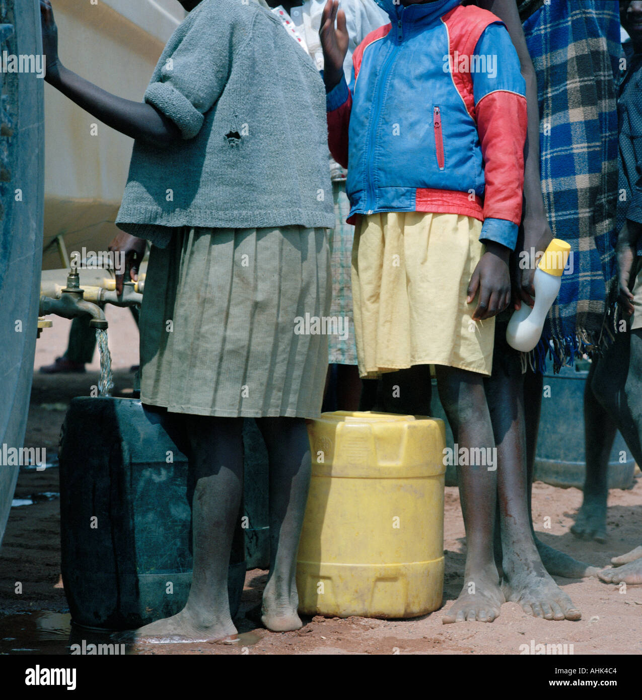 Children in Diveni village in drought stricken Venda in South Africa collect emergency water supplies from a tanker - Stock Image